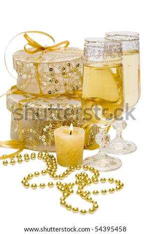 Composition of gift boxes with candle and glasses of champagne - stock photo