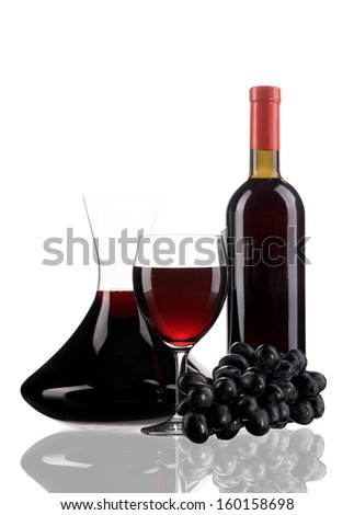Composition of grapes and red wine. Isolated on a white background. - stock photo