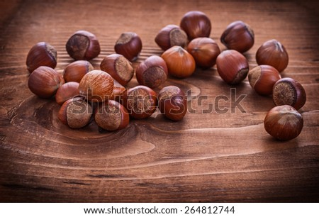 composition of hazelnuts on vintage wooden board food and drink concept  - stock photo