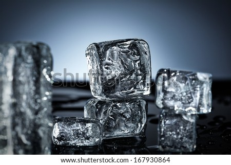Composition of ice cubes on black surface - stock photo