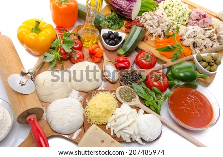 Composition of ingredients to make a pizza - stock photo