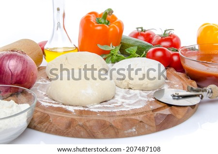 Composition of ingredients to make a pizza, isolated on white