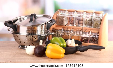 composition of kitchen tools,spices and vegetables on table in kitchen - stock photo