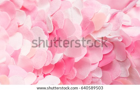 Composition of light spring pink textile petals. Flower blossom wallpaper, top view