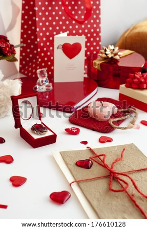 Composition of many festive objects-gift boxes, presents, greeting cards, ribbons and jewellery.