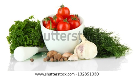 Composition of mortar, spices, tomatoes and  green herbs, isolated on white