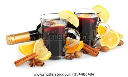 Composition of mulled wine and citrus isolated on white background