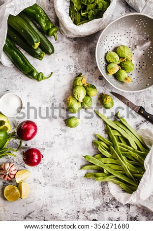 Composition of organic veggies on a stone table .  - stock photo