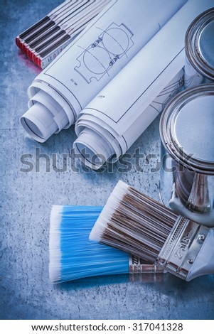 Composition of paint brushes cans construction drawings wooden meter.