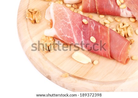 Composition of prosciutto on wooden platter. Whole background.