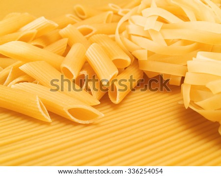 Composition of raw pasta of all types - spaghetti, penne, fusilli, macaroni etc.