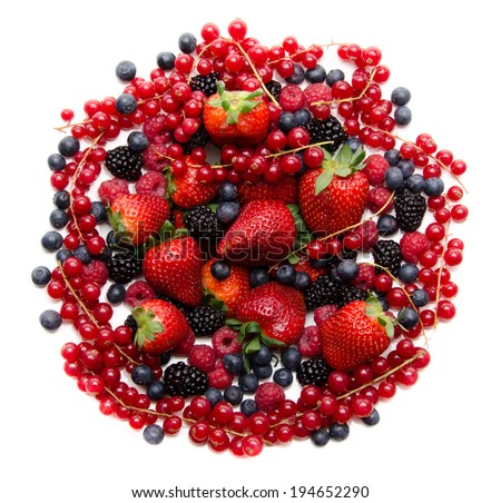 Composition of red and black fresh fruits, isolated on white - stock photo