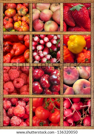 Composition of red fruits and vegetables framed in wood - stock photo