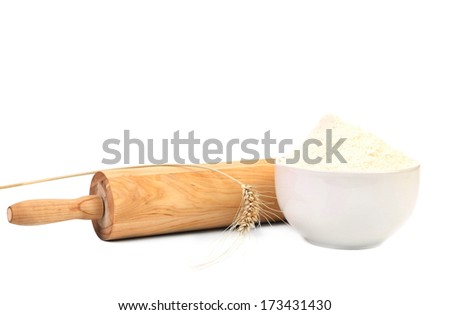 Composition of roll pin and wheat flour. Isolated on a white background. - stock photo
