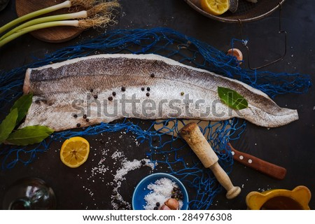 Big mirror carp on unhooking mat stock photo 357565559 for Aromatic herb for fish