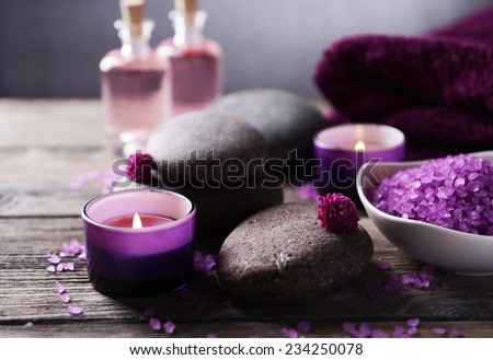 Composition of spa treatment on table on grey background - stock photo