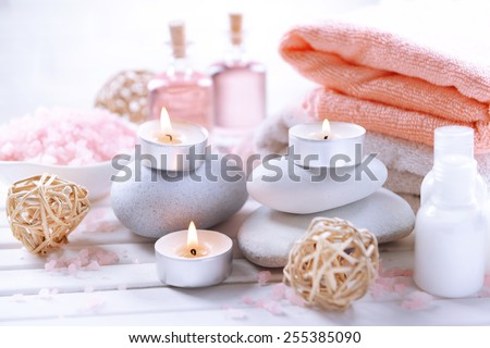 Composition of spa treatment on table on white background - stock photo