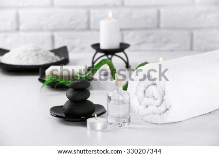 Composition of spa treatment on table, on white background - stock photo