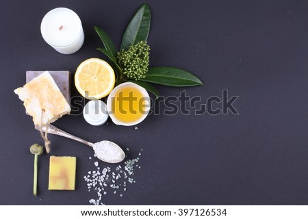 Composition of spa treatment on the black table - stock photo