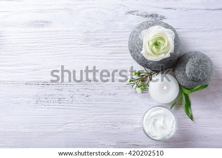 Composition of spa treatment on white wooden background - stock photo