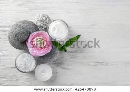Composition of spa treatment on white wooden background