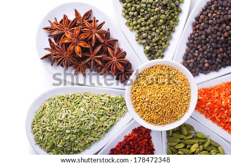 composition of spices over white background - stock photo
