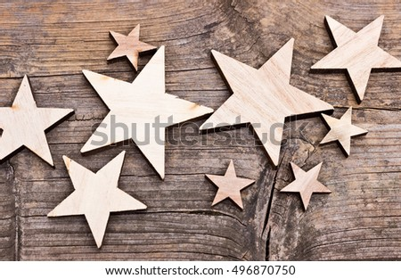 Composition of stars made of wood on a wooden background