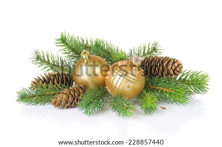 Composition of the Christmas balls, fir branches and cones on a white background - stock photo