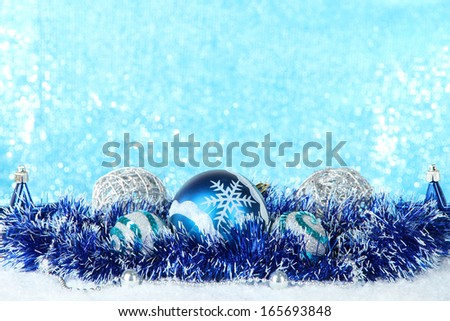 Composition of the Christmas decorations on light blue background - stock photo