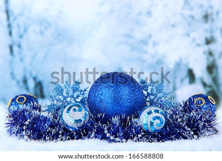 Composition of the Christmas decorations on light winter background - stock photo