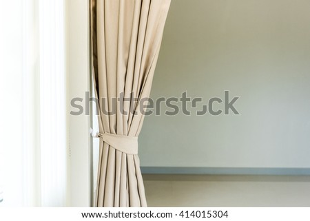 Composition of the elegant curtains against a wall