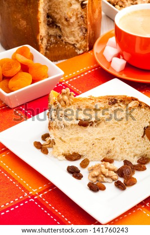 Composition of the italian cake with nuts and raisins