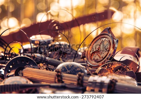 Composition of the old broken watches, with protruding springs and tools