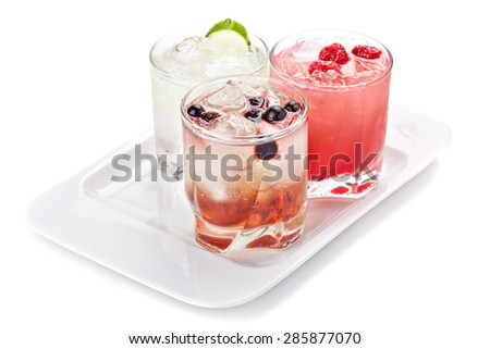 Composition of the three variants of alcoholic cocktails, isolated on white background. - stock photo