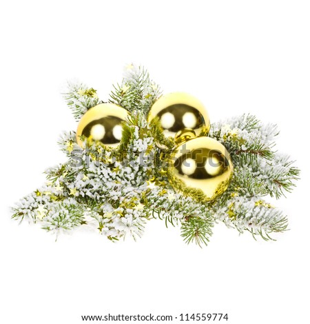 composition of three golden christmas ball against the snow, fir branches and gold foil stars. isolated on white background - stock photo