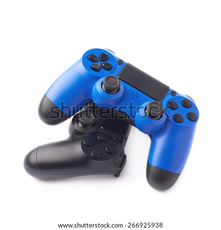 Composition of two gaming console controller gamepad devices, black and blue, isolated over the white background - stock photo