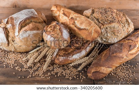 Composition of various breads, on wooden background