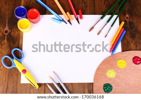 Composition of various creative tools on table close-up - stock photo