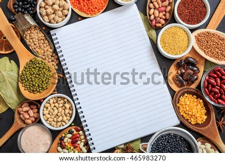 Composition of various kinds of legumes on black background