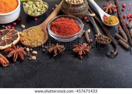 Composition of various spices on a black background