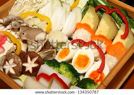 Composition of vegetables on wooden background.