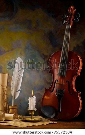 composition of violin and antique items - stock photo