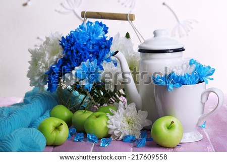 Composition of white and blue chrysanthemum and utensil close-up - stock photo