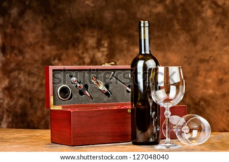 Composition of wine bottle and two wine glasses - stock photo