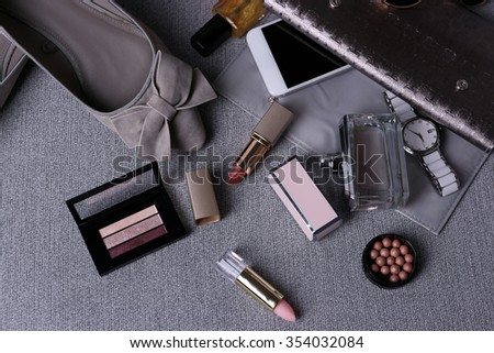 Composition of woman's fashion look on  gray background - stock photo