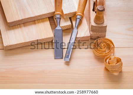 composition of woodworking tools carpentry chisels and plane on wooden boards  - stock photo