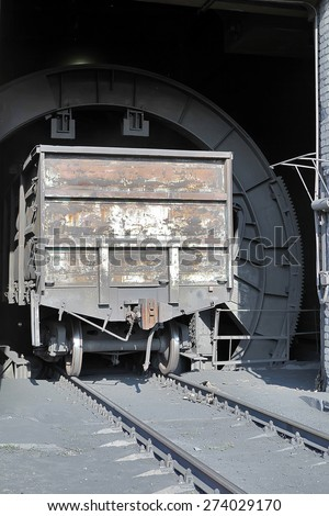 Composition station coal. Unloading of coal. Boxcar. Gold Donetsk. - stock photo