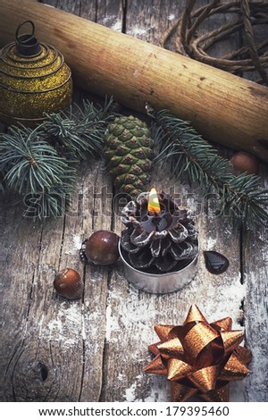 composition with a burning candle in Christmas decoration