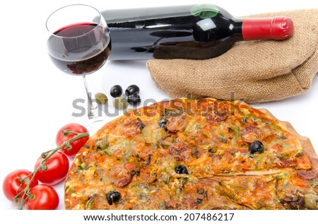Composition with a pizza, a glass and a bottle of wine, isolated on white