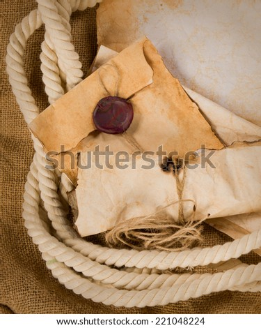 composition with an old envelope, parchment and rope  - stock photo